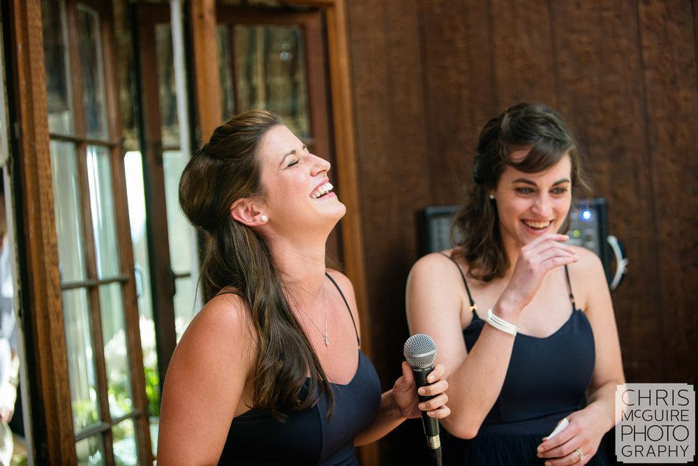 bridesmaids laughing during speech