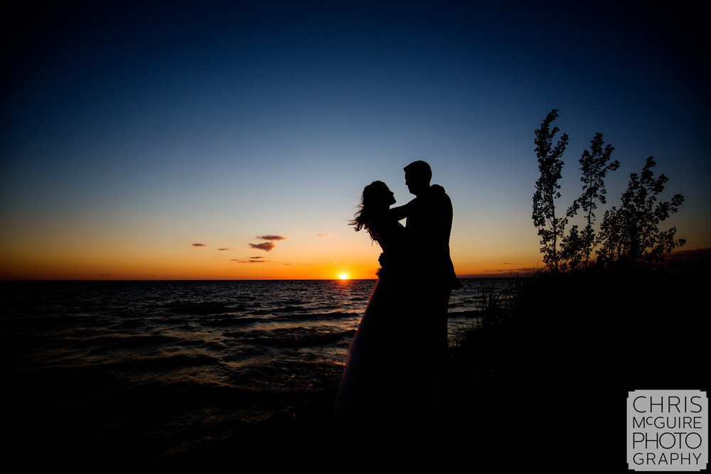 bride groom sunset lake michigan