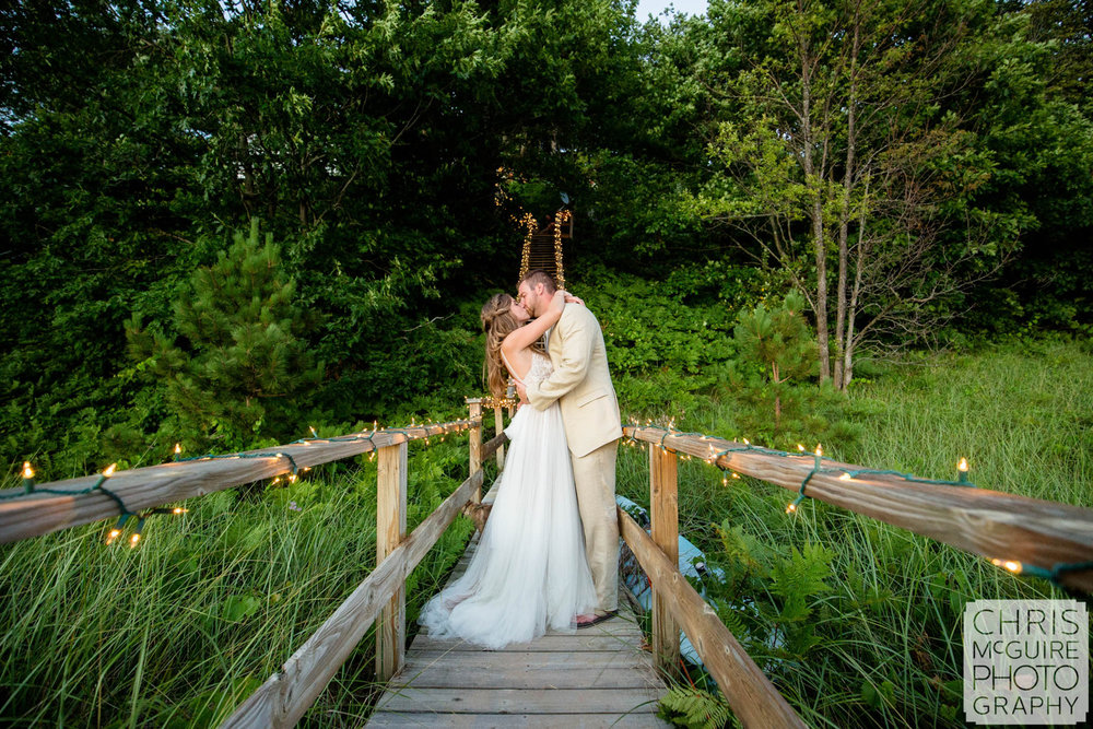 bride groom kissing by lake michigan