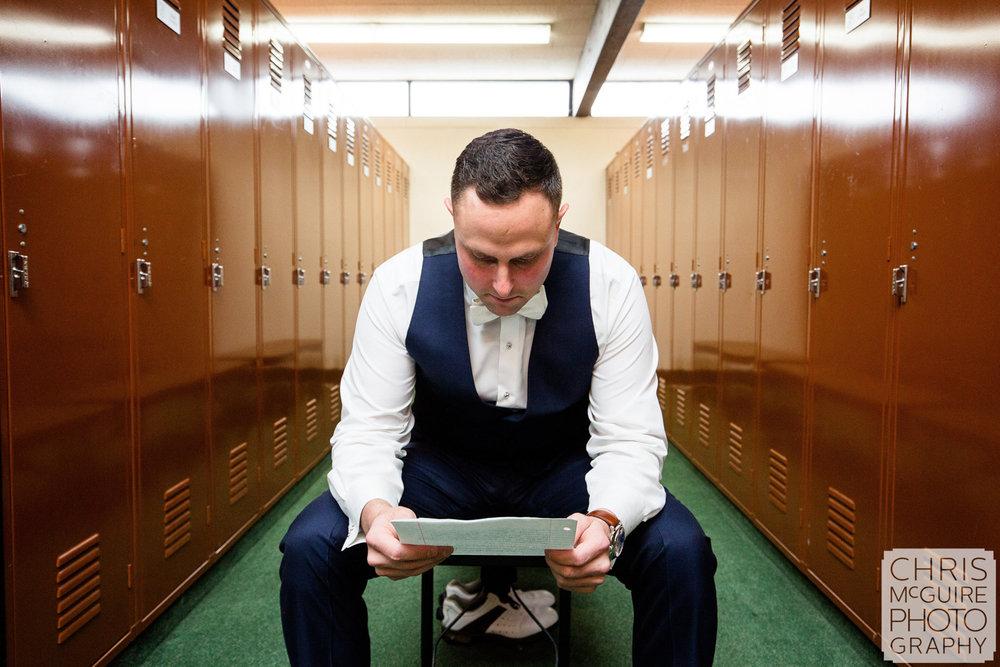 groom reading letter in locker room