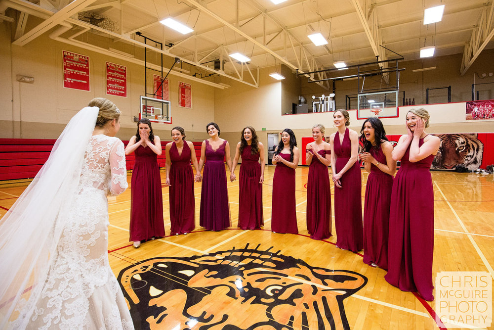 bride reveal to bridesmaids in gym