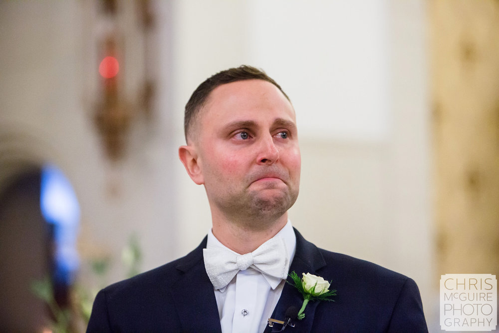 groom crying as he sees bride first time at wedding