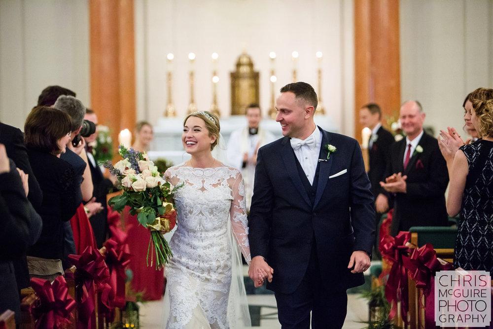 bride groom walking down aisle