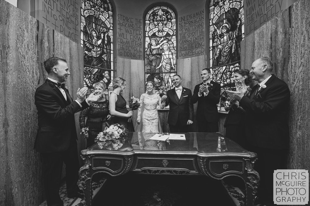 parents clapping for bride groom