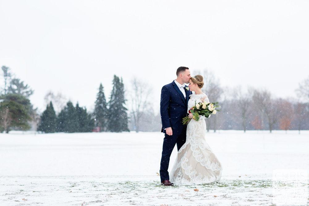 bride groom artistic portrait in snow winter wedding