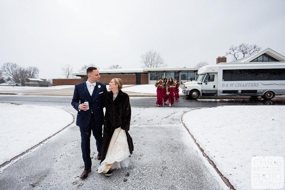 bride groom walking in snow