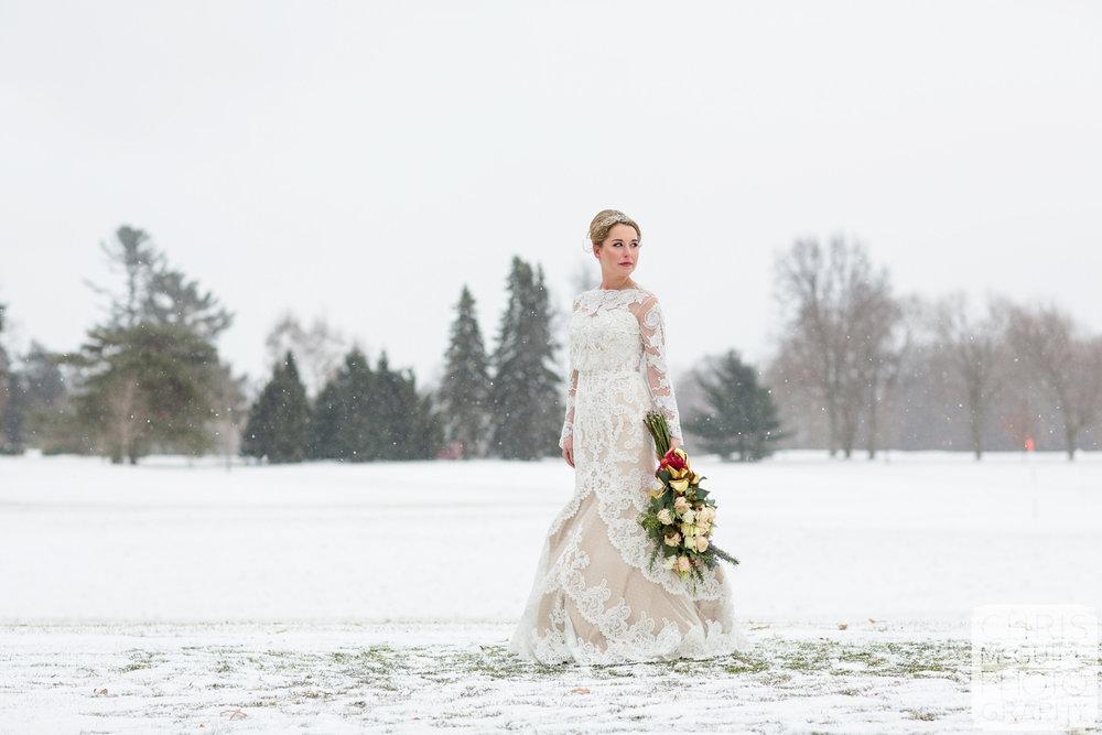 bride in snow winter wedding midwest