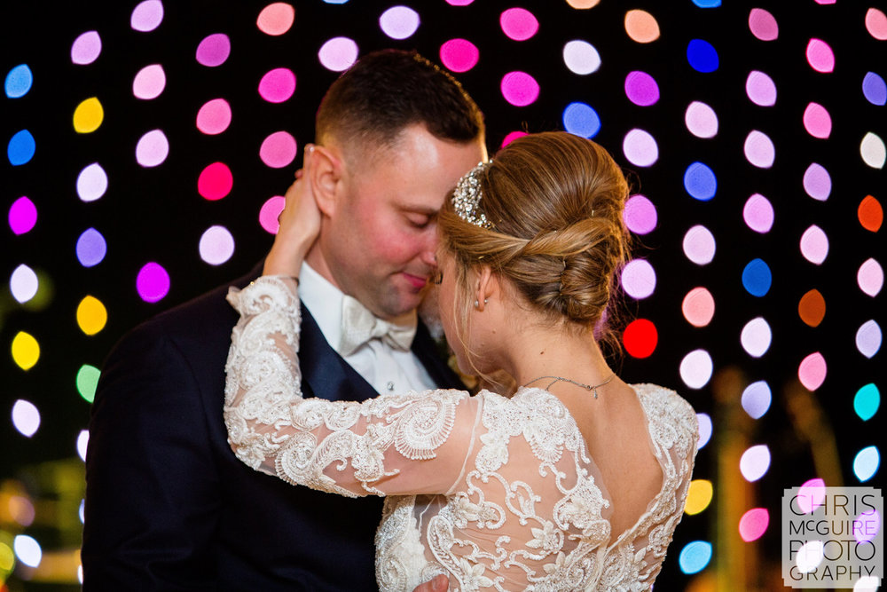 bride groom first dance colorful lights