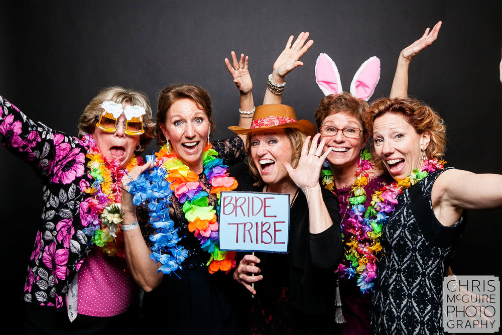 bride tribe in wedding photo station