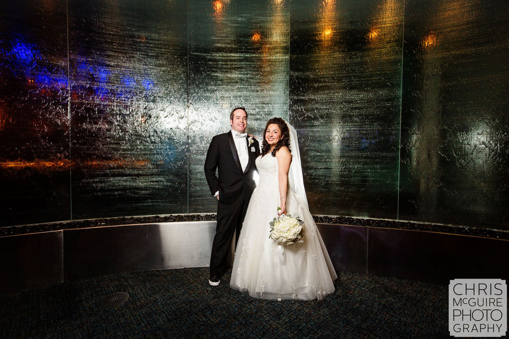 bride groom waterfall wall