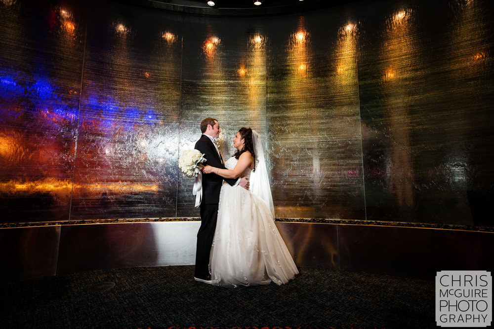 bride groom waterfall wall in casino wedding