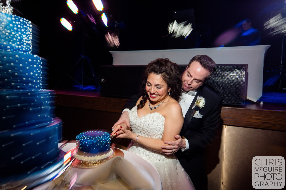 bride groom cutting blue wedding cake