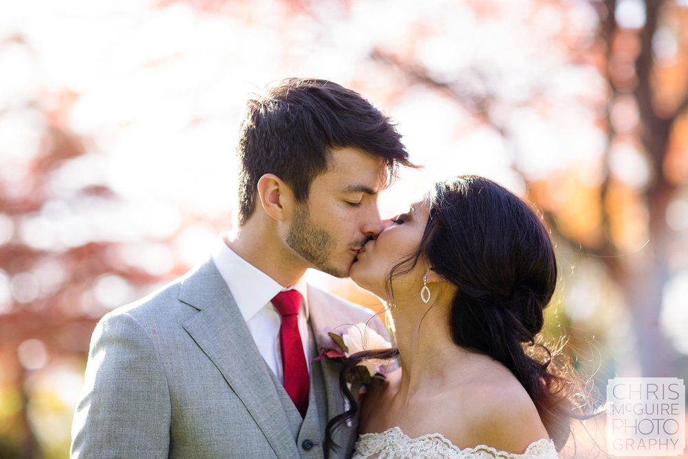 fall wedding bride groom kiss chris mcguire photography