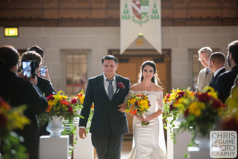 bride with father walking down aisle in church wedding
