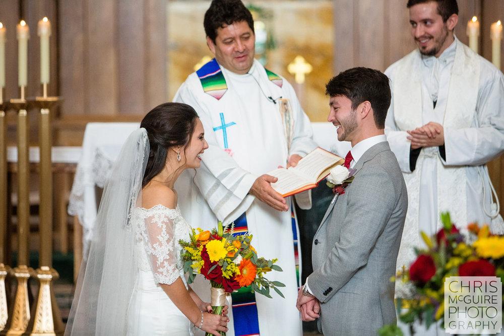 bride groom laughing during wedding