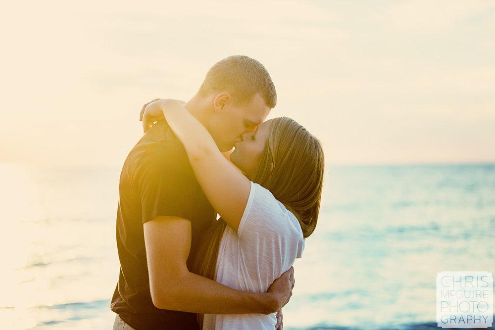 couple kissing at lake michigan