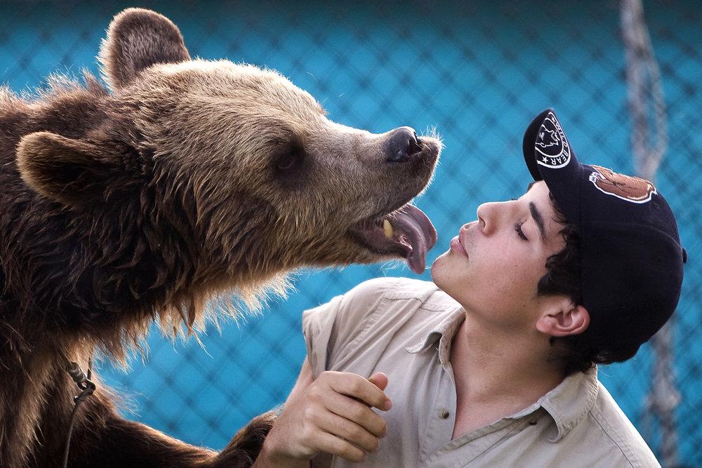bear licking man