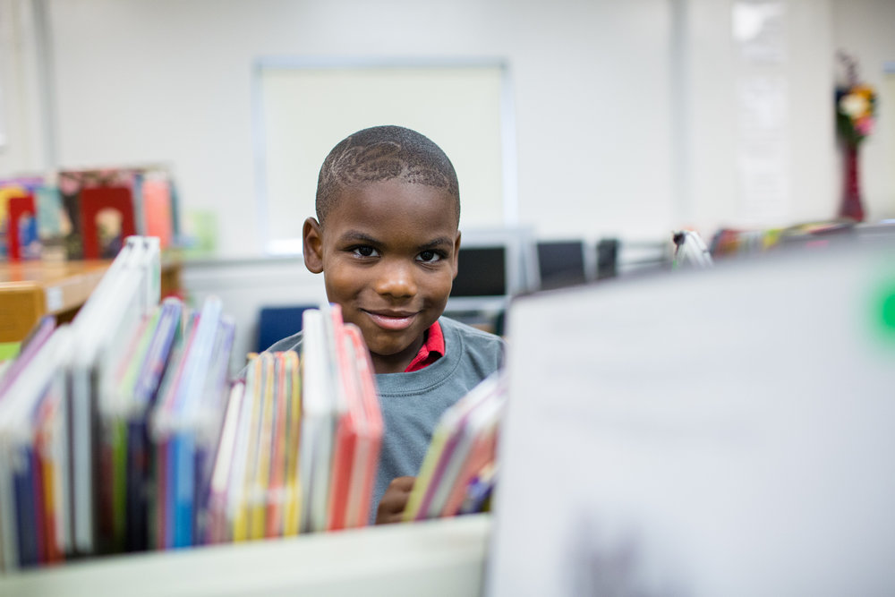boy in library editorial photography