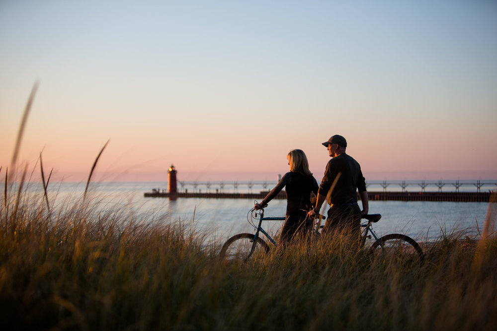 couple at sunset with lake and pier