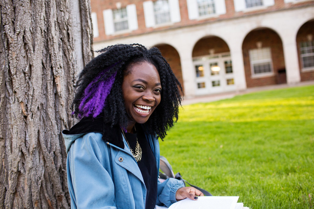 student laughing on campus