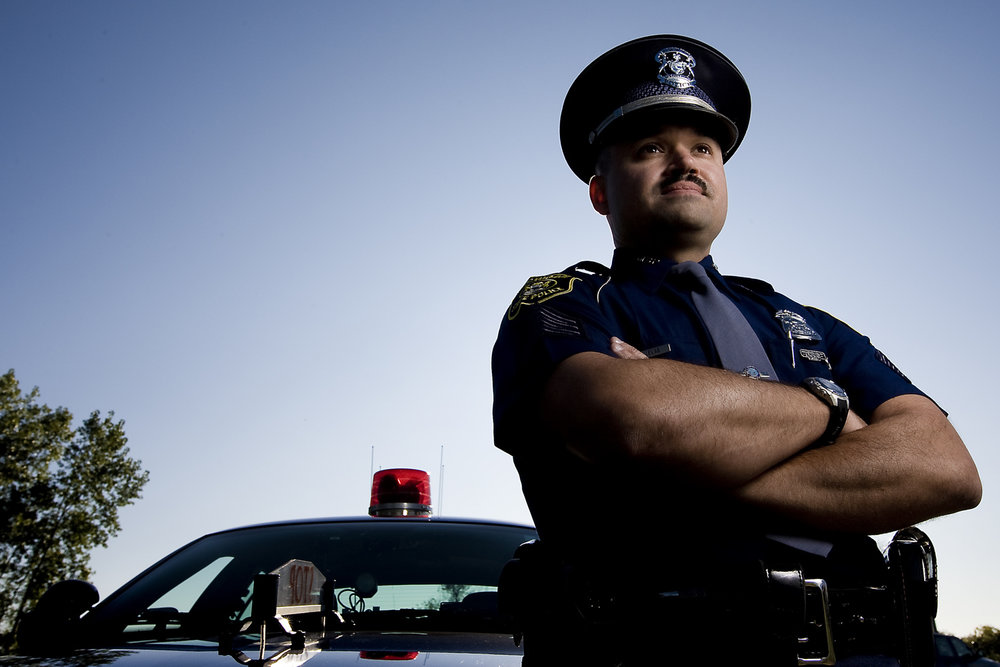 michigan state trooper with squad car editorial portrait