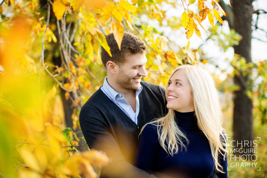 couple smiling with yellow leaves chicago in fall