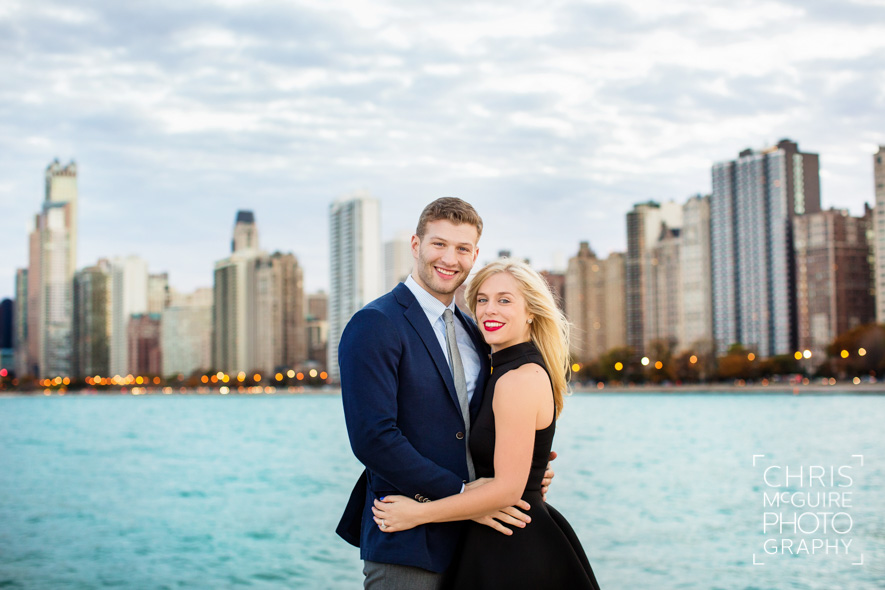 engaged couple with chicago skyline lake michigan