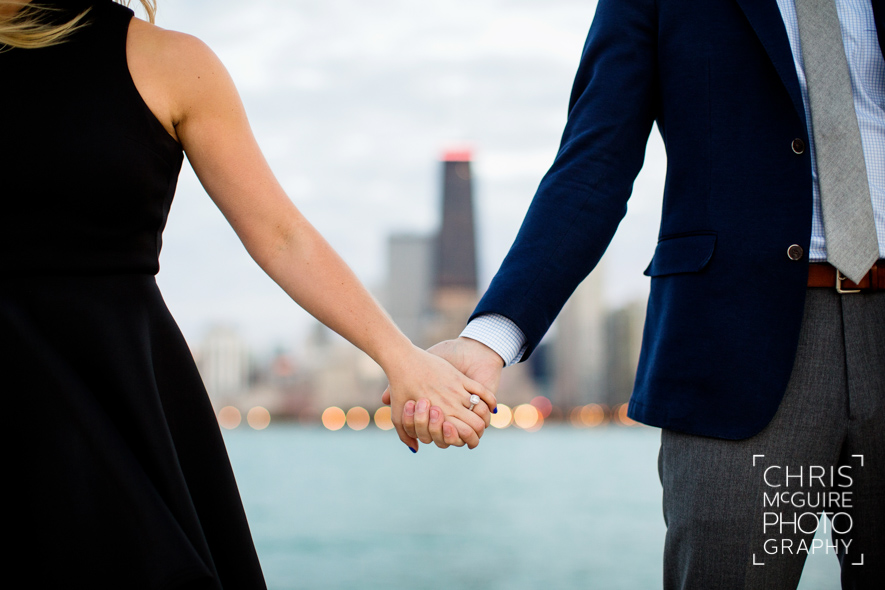 couple holding hands chicago skyline