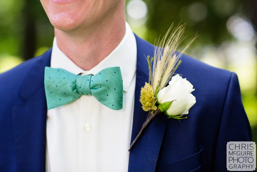 groom with bowtie and boutonniere
