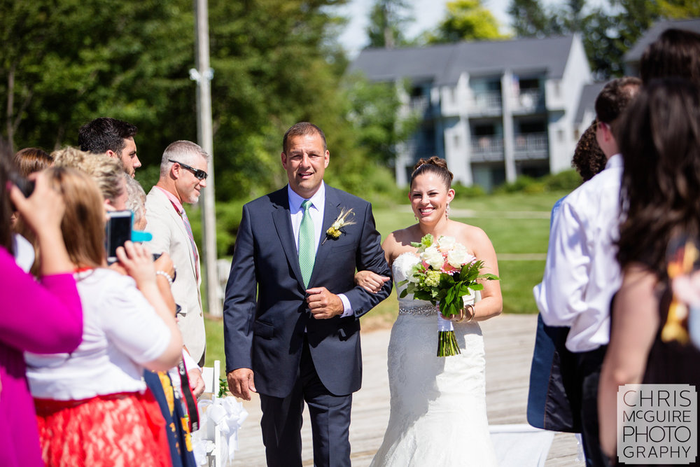 bride with father walking down aisle outdoor wedding