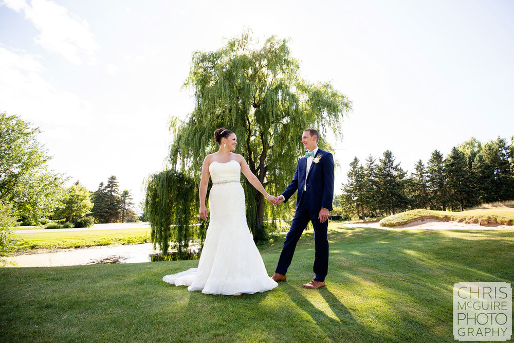 bride groom pose on golf course