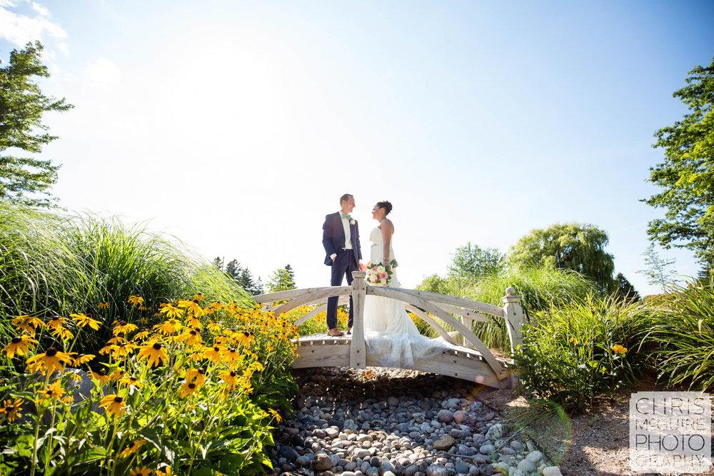 bride groom pose on bridge