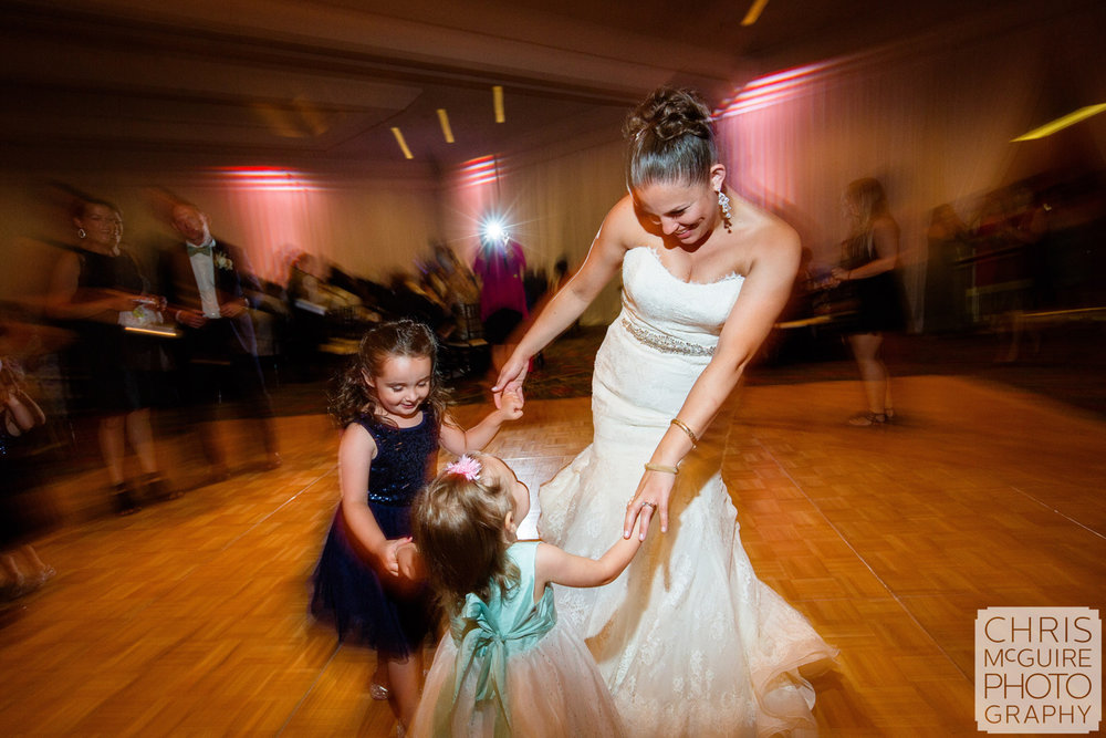 bride dancing with children at wedding reception