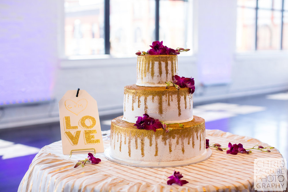 gold wedding cake in loft