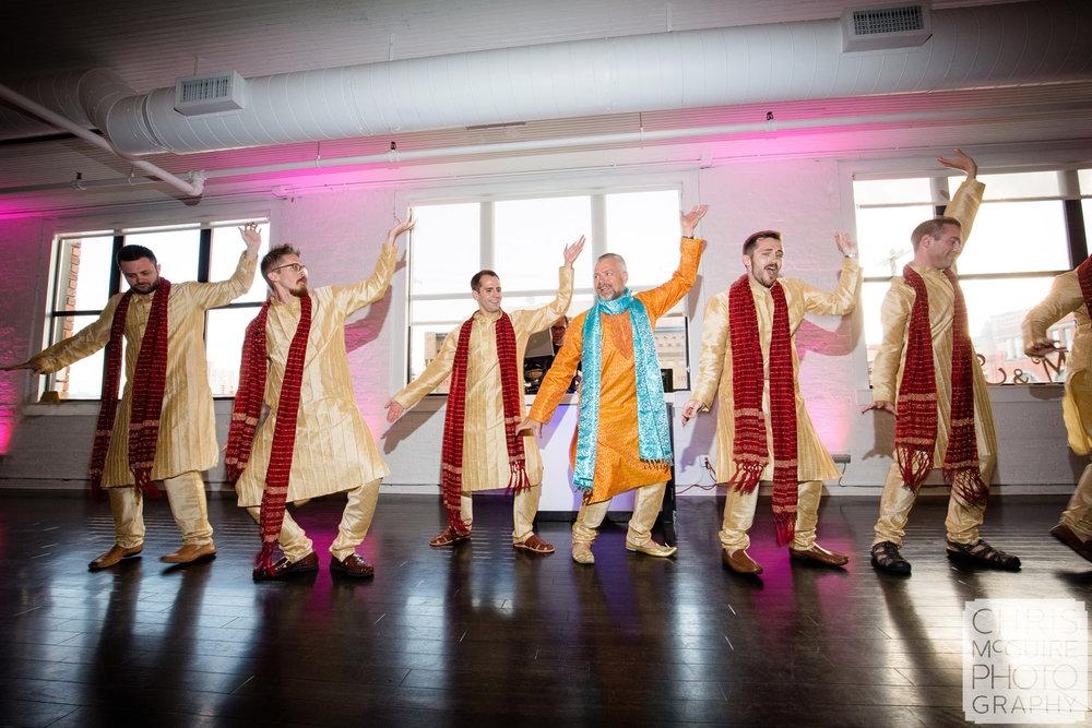 indian wedding guys dancing