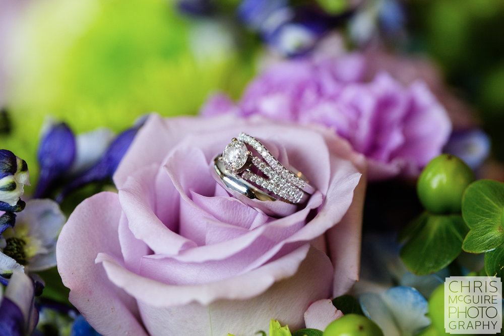wedding rings with purple flowers