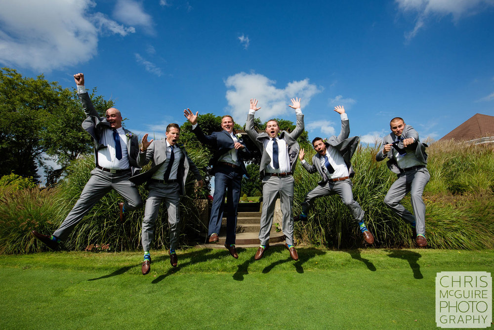 groom groomsmen jumping