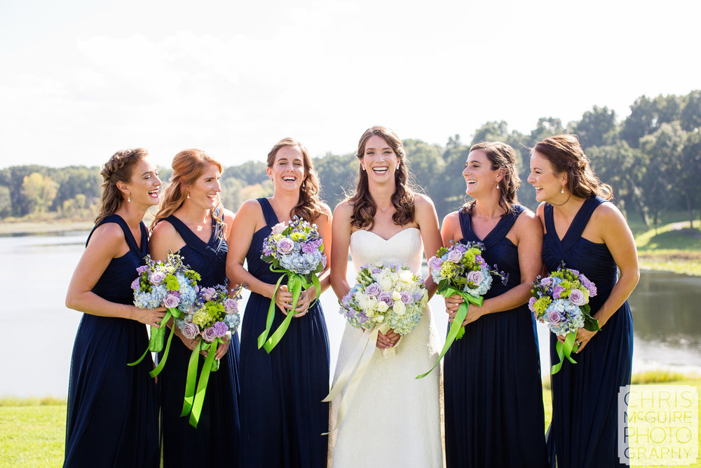 bride bridesmaids laughing with bouquets