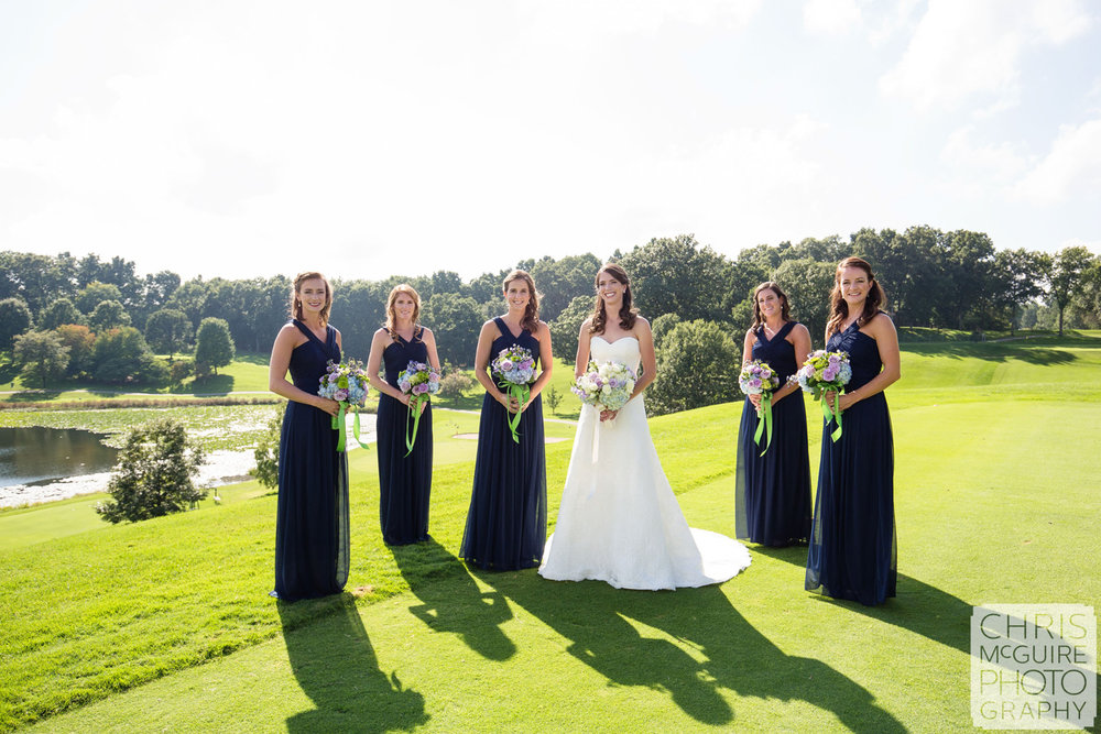bride bridesmaids with bouquets on golf course