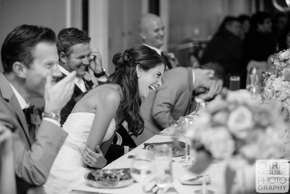 wedding party laughing during toast