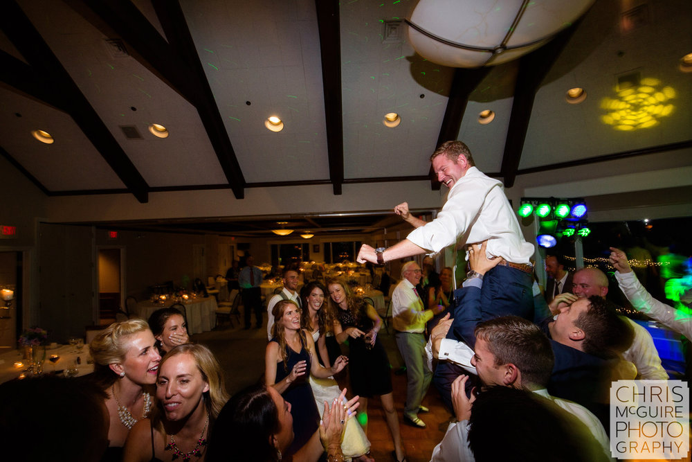 groom on shoulders dancing