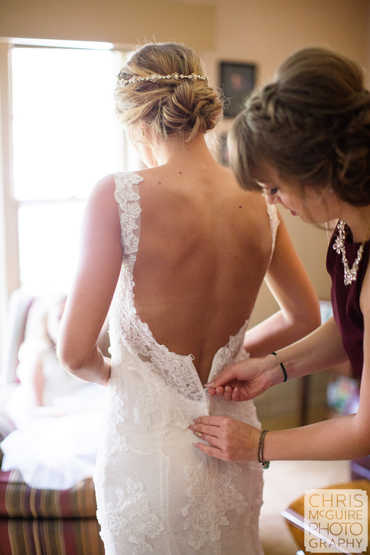 bride zipping dress peoria