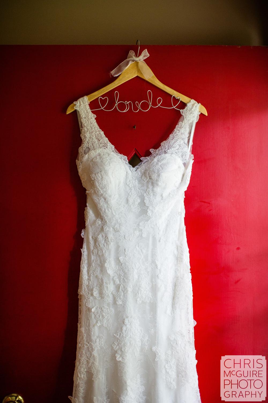 wedding dress on red door