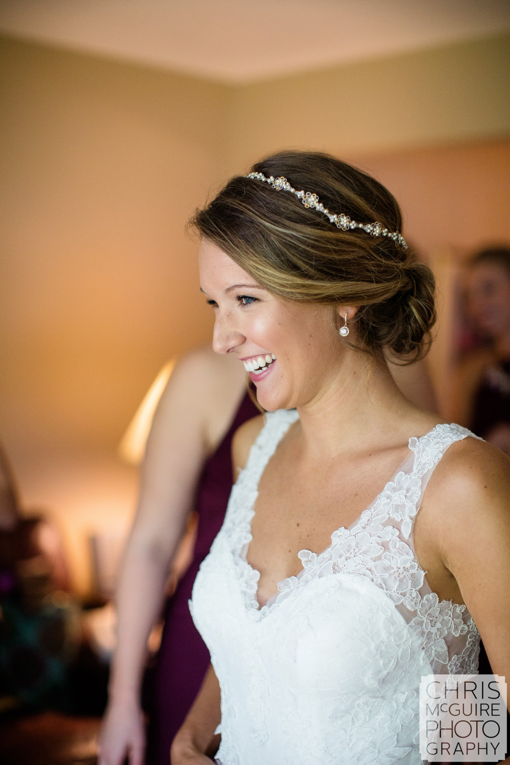 bride smiling while getting ready for central illinois wedding