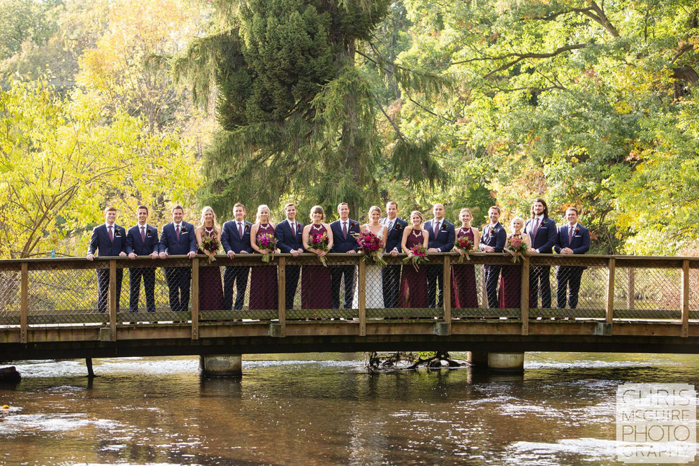 midwest wedding party on bride in fall