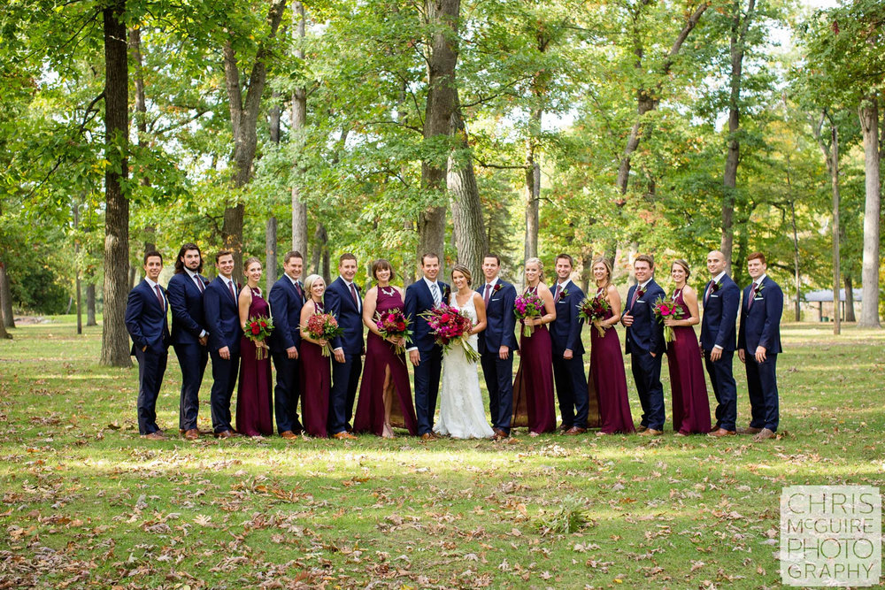 large wedding party at park in fall