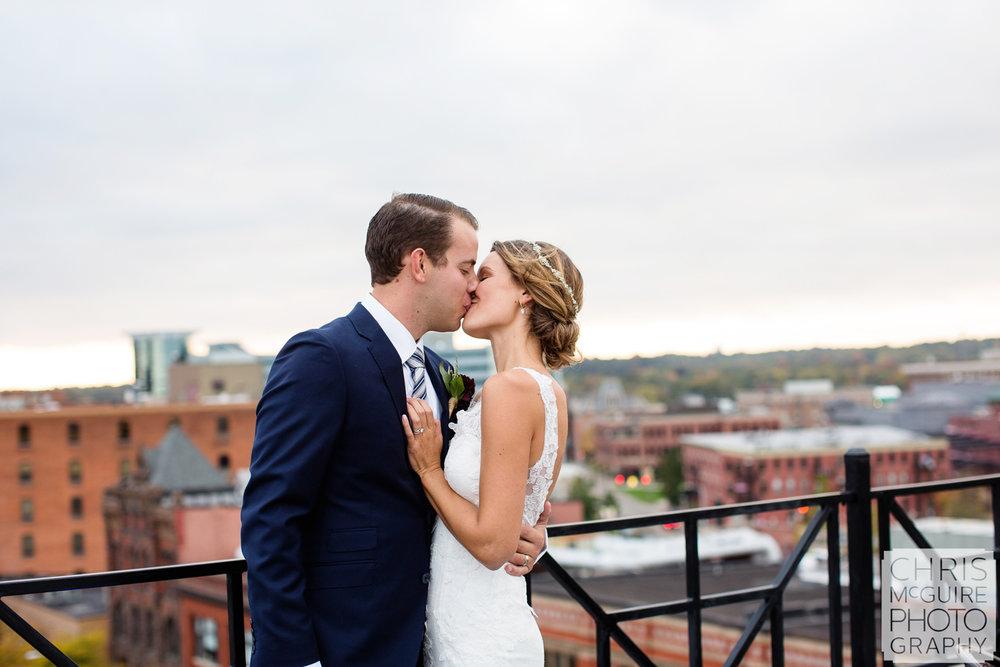 bride groom kiss on rooftop skydeck
