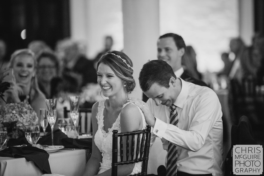 bride groom laughing during toast