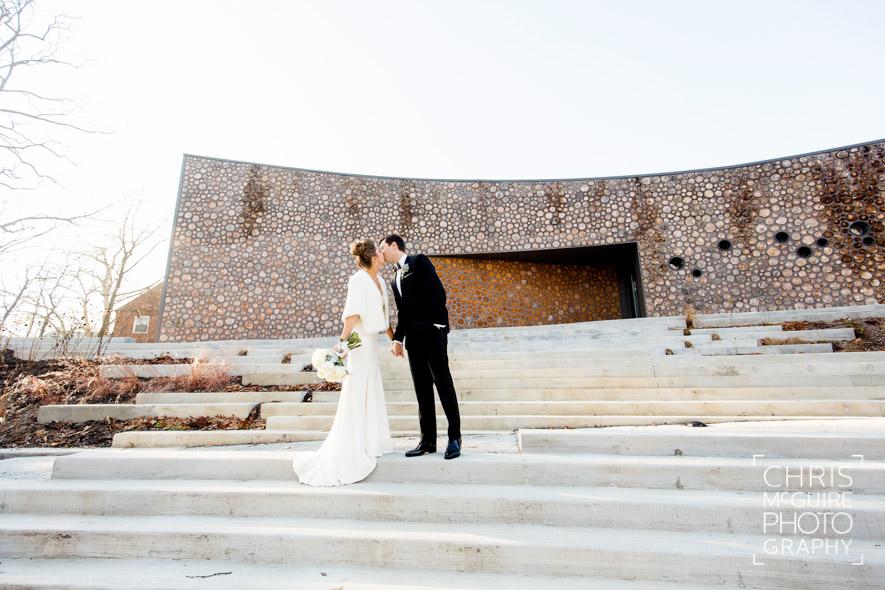 bride groom kissing on steps