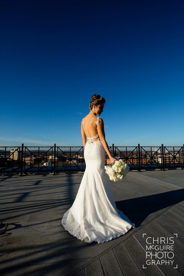 bride in wedding dress on rooftop
